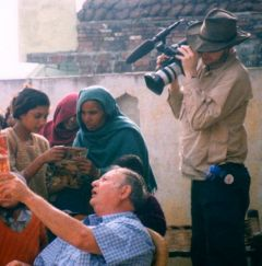 Cinematographer filming village women and Dr. Mahar