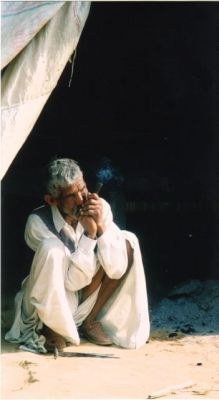 village man smoking chillum